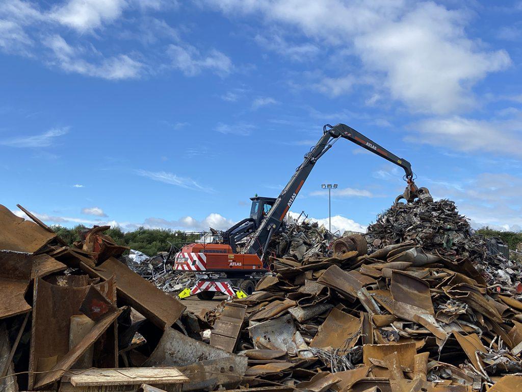 Atlas 350MH material handling excavator moving scrap metal