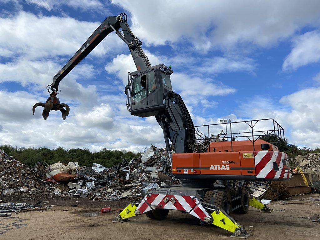 Atlas 350MH material handler with grab in scrap metal yard