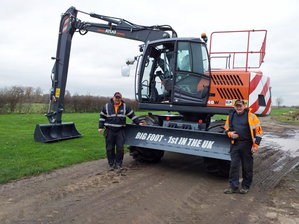 Richard and Dave Bichan with new Atlas 140W Bigfoot Wheeled Excavator