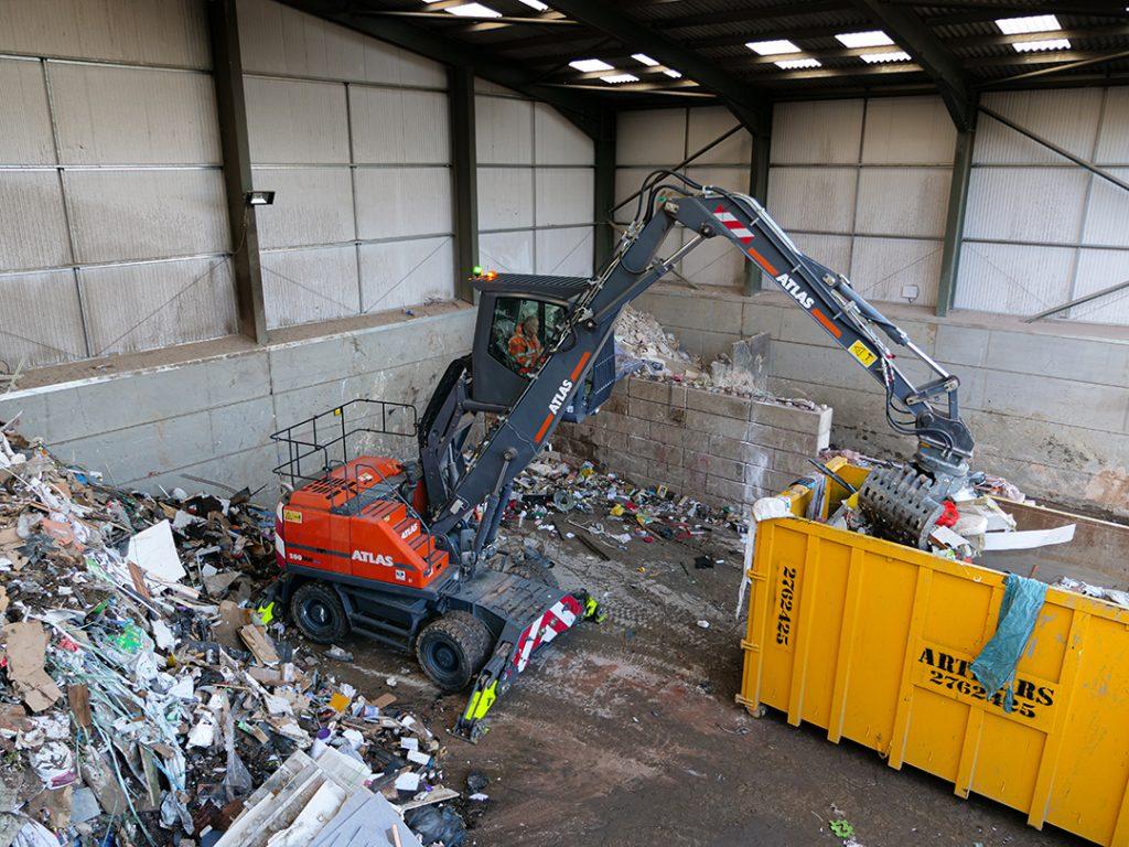 Atlas 200MH Material Handler with Selector Geab sorting Waste at Banks Skip Hire Ltd