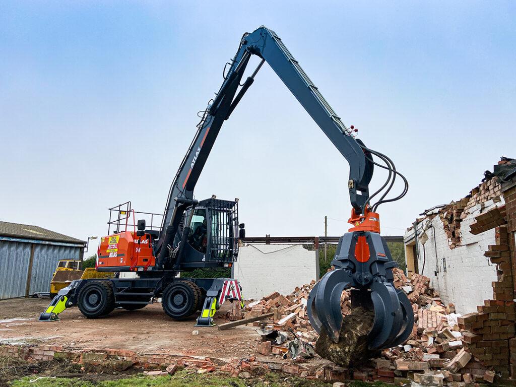 atlas 250mh material handler demolishing petrol station