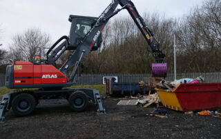 Atlas 200MH material handler with prodem grab