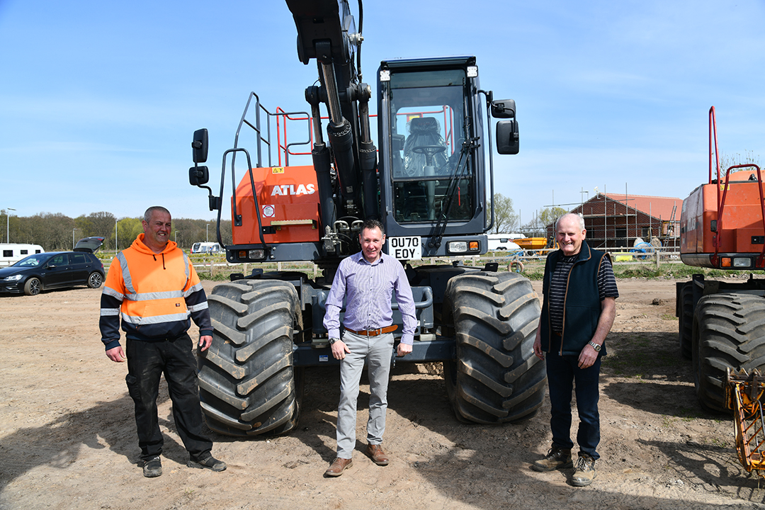 New Owners Richard and Dave Bichan anc TDL sales manager Gaz Bourner with new Atlas 140W bigfoot wheeled excavator